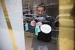 A man attaching a wish card in the window the Referendum Cafe in the centre of Glasgow on the day that Scotland voted in the independence referendum. Yes Scotland were campaigning for the country to leave the United Kingdom, whilst Better Together were campaigning for Scotland to remain in the UK. On the 18th of September 2014, the people of Scotland voted in a referendum to decide whether the country's union with England should continue or Scotland should become an independent nation once again and leave the United Kingdom.