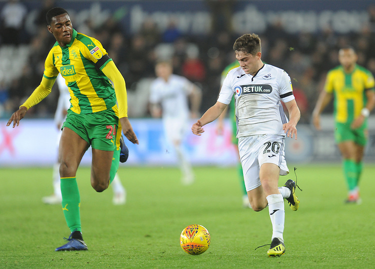 Swansea City's Dan James under pressure from West Bromwich Albion's Tosin Adarabioyo<br /> <br /> Photographer Kevin Barnes/CameraSport<br /> <br /> The EFL Sky Bet Championship - Swansea City v West Bromwich Albion - Wednesday 28th November 2018 - Liberty Stadium - Swansea<br /> <br /> World Copyright &copy; 2018 CameraSport. All rights reserved. 43 Linden Ave. Countesthorpe. Leicester. England. LE8 5PG - Tel: +44 (0) 116 277 4147 - admin@camerasport.com - www.camerasport.com