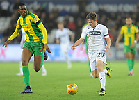 Swansea City's Dan James under pressure from West Bromwich Albion's Tosin Adarabioyo<br /> <br /> Photographer Kevin Barnes/CameraSport<br /> <br /> The EFL Sky Bet Championship - Swansea City v West Bromwich Albion - Wednesday 28th November 2018 - Liberty Stadium - Swansea<br /> <br /> World Copyright © 2018 CameraSport. All rights reserved. 43 Linden Ave. Countesthorpe. Leicester. England. LE8 5PG - Tel: +44 (0) 116 277 4147 - admin@camerasport.com - www.camerasport.com