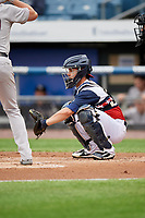 Syracuse Chiefs catcher Tuffy Gosewisch (11) waits to receive a pitch during a game against the Scranton/Wilkes-Barre RailRiders on June 14, 2018 at NBT Bank Stadium in Syracuse, New York.  Scranton/Wilkes-Barre defeated Syracuse 9-5.  (Mike Janes/Four Seam Images)