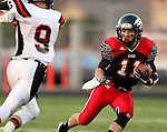 BRANDON, SD - SEPTEMBER 26: Riley Frantzen #11 from Brandon Valley looks as Zach Devries #9 from Washington closes in during the first quarter of their game Friday night in Brandon.  (Photo by Dave Eggen/Inertia)