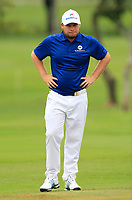 Tyrrell Hatton (Europe) on the 1st green during the Singles Matches of the Eurasia Cup at Glenmarie Golf and Country Club on the Sunday 14th January 2018.<br /> Picture:  Thos Caffrey / www.golffile.ie