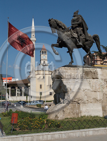 Tirana/Tirane-Albania - August 01, 2004---Seen from Skenderberg/Skanderberg Square: Clock tower (built in 1830), Minaret and the Mosque of Ethem Mey (built in 1793), National Albanian Flag and Statue, in the center of Tirana, capital city of Albania; culture-religion---Photo: Horst Wagner/eup-images