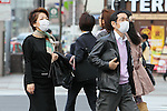 March 8, 2013, Tokyo, Japan :  People wear protective face masks in downtown Tokyo. Hay Fever and pollution cloud form China hit Japan. In Tokyo, and throughout Japan, Spring is the Hay fever season. Hay fever, or Kafunsho, is most commonly caused by pollen from Cryptomeria and Japanese Cypress, two native Japanese tree species. Japan is particularly subject to hay fever due to the great number of Cryptomeria and Japanese Cypress tree reforestation in the 70s, where these species were important resources for the construction industry. This year the hay fever season is also influenced by the Asian Dust, a flow of dust and pollution brought to Japan from China by strong westerly winds. (Photo by Yohei Osada/AFLO)