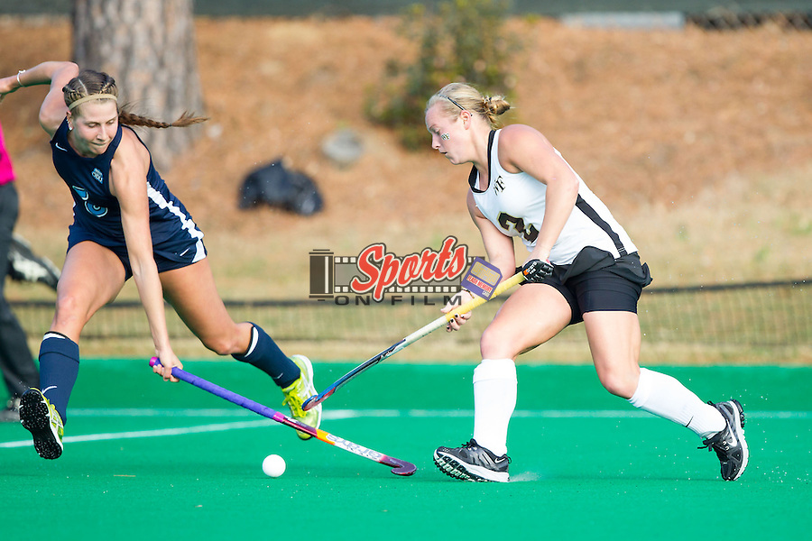 Taylor Rhea (2) of the Wake Forest Demon Deacons battles for the ball with Christy Longacre (5) of the Old Dominion Monarchs during Round One of the 2013 NCAA Field Hockey Championship at Francis E. Henry Stadium on November 16, 2013 in Chapel Hill, North Carolina.  The Demon Deacons defeated the Monarchs 3-2.  (Brian Westerholt/Sports On Film)