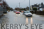 Cars struggle to get through the flood on the Scartaglen road in Castleisland on Sunday evening after the town was hit with a massive flash flood