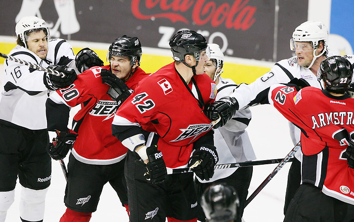 San Antonio Rampage players Bracken Kearns, left, and Nolan Yonkman, right, scrum with Abbotsford Heat players Lance Bouma, middle left, Raitis Ivanans, middle, and John Armstrong during the first period of an AHL hockey game, Tuesday, Nov. 15, 2011, in San Antonio. (Darren Abate/pressphotointl.com)