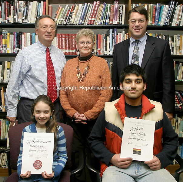 THOMASTON, CT -05 MARCH 2007 -030608DA02- Heather Gracy, sitting, left, a 5th grader at Thomaston Center School, and Massoud Salehi, sitting, right, a senior at Thomaston High School, have been honored for their volunteer service with a Prudential Spirit of the Community Award. Heather also received the President's Volunteer Service Award. Heather raised money for school supplies for students in need, while Massoud helped form the Students Against Destructive Decisions club, promoted a pledge drive, participated in candle lighting ceremony at a local Prevention Council meeting about the dangers of drugs and alcohol and designed an informational pamphlet for that meeting. To honor the students at Thomaston High School Wednesday are standing, from left, James Diorio, pricipal of Thomaston Center School, Joan Batten, school- to- career coordinator, and James Wenker, principal of Thomaston High School.<br /> Darlene Douty/Republican-American