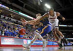 SIOUX FALLS, SD: MARCH 7: Tre'Shawn Thurman #15 from Omaha tries to grab the loose ball past Reed Tellinghuisen #23 from South Dakota State University during the Men's Summit League Basketball Championship Game on March 7, 2017 at the Denny Sanford Premier Center in Sioux Falls, SD. (Photo by Dave Eggen/Inertia)