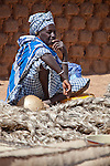 A woman sells rope in the weekly market of Djibo in northern Burkina Faso.