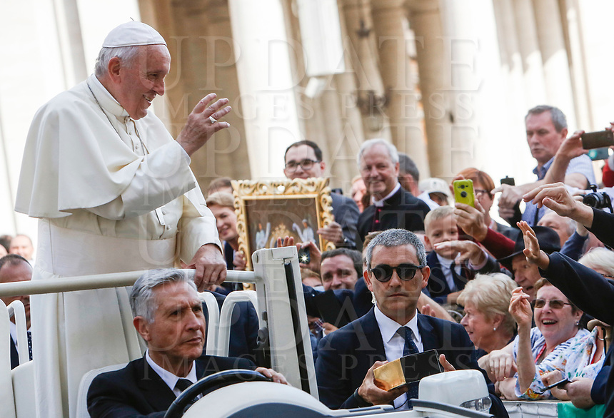 Pope Francis waves to the faithful as he leaves at the end of his weekly general audience in St. Peter's Square at the Vatican City, October 16, 2019. At right, with sunglasses, new Vatican head of security Gianluca Gauzzi Broccoletti.<br /> UPDATE IMAGES PRESS/Riccardo De Luca<br /> <br /> STRICTLY ONLY FOR EDITORIAL USE