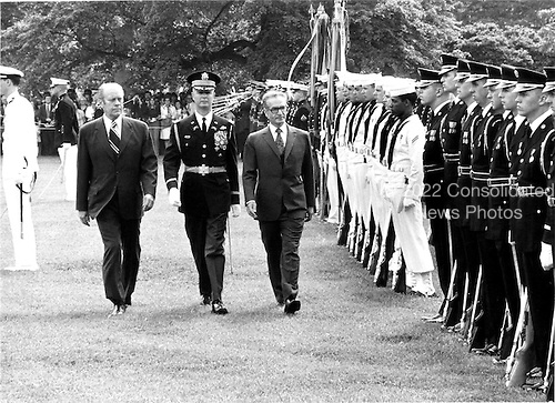 """United States President Gerald R. Ford and Mohammad Reza Pahlavi, the Shah of Iran troop the line during arrival ceremonies welcoming His Highness to the White House on May 15, 1975.<br /> Credit: Benjamin E. """"Gene"""" Forte - CNP"""