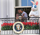 United States President Barack Obama kisses first lady Michelle Obama after introducing her to open the annual Easter Egg Roll on the South Lawn of the White House on April 21, 2014. <br /> Credit: Dennis Brack / Pool via CNP