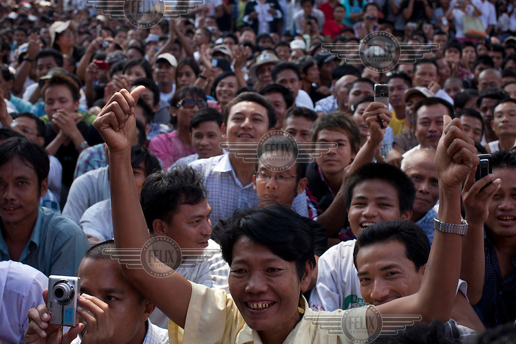 Supporters of Myanmar's newly-released opposition leader Aung San Suu Kyi react as they listen to her speak at the National League for Democracy (NLD) headquarters in Rangoon. From 1990 until her release on 13 November 2010, Aung San Suu Kyi had spent almost 15 of the 21 years under house arrest.