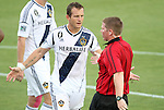 29 May 2012: Los Angeles' Chad Barrett (9) talks to referee Kevin Terry (right). The Carolina RailHawks (NASL) defeated the Los Angeles Galaxy (MLS) 2-1 at WakeMed Soccer Stadium in Cary, NC in a 2012 Lamar Hunt U.S. Open Cup third round game.
