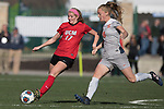 KANSAS CITY, MO - DECEMBER 02: Megan Woolley (17) of the University of Central Missouri attempts a pass past Lauren Wade (11) of Carson-Newman University during the Division II Women's Soccer Championship held at the Swope Soccer Village on December 2, 2017 in Kansas City, Missouri. (Photo by Doug Stroud/NCAA Photos/NCAA Photos via Getty Images)