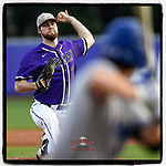 Starting pitcher John Michael Bertrand (32) of the Furman Paladins delivers a pitch in a game against the UNC Asheville Bulldogs on Wednesday, February 27, 2019, at Latham Baseball Stadium on the Furman University campus in Greenville, South Carolina. UNC Asheville won, 4-3. (Tom Priddy/Four Seam Images)