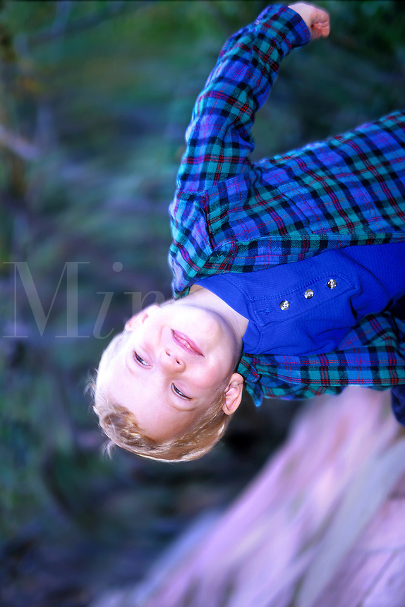 Blond hairand blue eyed child playing with motion and  photographer. (Number 3 of a series.