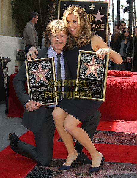William H. Macy & Felictiy Huffman .Felictiy Huffman And William H. Macy Hollywood Walk Of Fame Induction Ceremony Held At On the Walk of Fame, Hollywood, California, USA.  .March 7th, 2012.full length moustache mustache facial hair married husband wife black suit dress suit kneeling sitting on knee.CAP/ADM/KB.©Kevan Brooks/AdMedia/Capital Pictures.