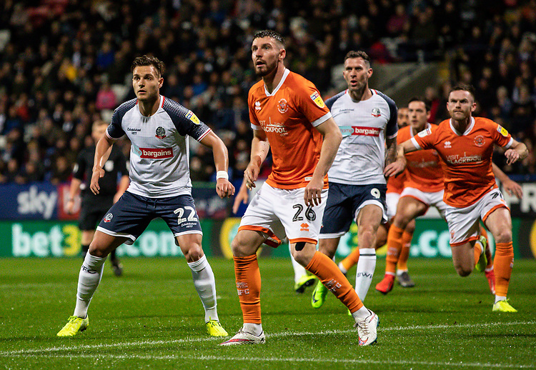 Bolton Wanderers' Dennis Politic (left) competing with Blackpool's James Husband waiting for a corner kick<br /> <br /> Photographer Andrew Kearns/CameraSport<br /> <br /> The EFL Sky Bet League One - Bolton Wanderers v Blackpool - Monday 7th October 2019 - University of Bolton Stadium - Bolton<br /> <br /> World Copyright © 2019 CameraSport. All rights reserved. 43 Linden Ave. Countesthorpe. Leicester. England. LE8 5PG - Tel: +44 (0) 116 277 4147 - admin@camerasport.com - www.camerasport.com