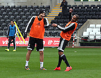 Wednesday, 23 April 2014<br /> Pictured L-R: Jonjo Shelvey and Ashley Williams play-fighting during training. <br /> Re: Swansea City FC are holding an open training session for their supporters at the Liberty Stadium, south Wales,