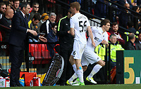 Jay Fulton of Swansea City is replaced byTom Carroll of Swansea City during the Premier League match between Watford and Swansea City at Vicarage Road Stadium, Watford, England, UK. Saturday 15 April 2017