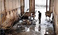 Nederland -  Amsterdam -  2018.  De Kinkerbuurt. De kelder onder appartementen wordt uitgegraven. Muur wordt gestut. De fundering wordt hersteld.  Foto Berlinda van Dam / Hollandse Hoogte