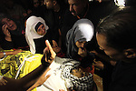 """The Palestinian mother of Mohammed Abu Saada, a 26-year-old Palestinian man who was reportedly killed in clashes with the Israeli army along the Gaza border, mourns during his funeral in the Nuseirat refugee camp in the central Gaza Strip on November 19, 2016. """"Mohammed Abu Saada died after being shot in the chest by Israeli soldiers in clashes east of the Al-Bureij camp,"""" the health ministry in the Palestinian enclave on November 18. The Israeli army confirmed clashes in the area, which is in central Gaza, but could not immediately provide details. Photo by Ashraf Amra"""