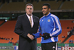 27 October 2007: Kansas City Technical Director Peter Vermes presents Jose Burciaga, Jr. (r) with the team's Humanitarian of the Year award. The Kansas City Wizards defeated Club Deportivo Chivas USA 1-0 in the first leg of their Major League Soccer Western Conference Semifinal playoff series at Arrowhead Stadium in Kansas City, Missouri.