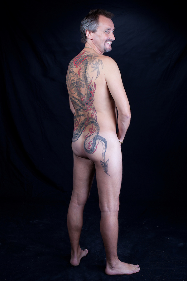 Danish man with dragon tattoo on his back.<br />