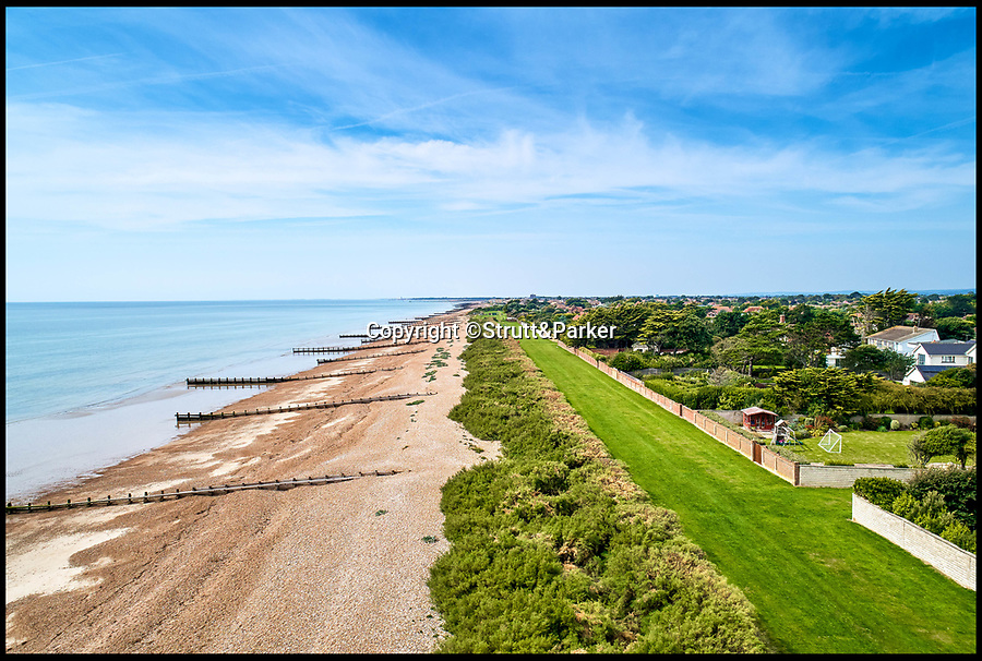 BNPS.co.uk (01202 558833)<br /> Pic:  Strutt&Parker/BNPS<br /> <br /> A brand new luxury house that wouldn't look out of place in a rural village but is literally a stone's throw from the beach has gone on the market for £3.25m.<br /> <br /> Gallic House has just been built in a sought-after gated coastal estate in the East Preston West Sussex.<br /> <br /> At the bottom of the garden an 8ft tall hedge has been grown to stop any nosey beachgoers from peering in.<br /> <br /> To make up for the lack of sea views from the ground floor, there is a large first floor balcony that looks out onto the beach and sea.