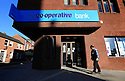 The troubled Co-operative Bank has reported a pre-tax loss of &pound;75.8m for the first half of 2014, down from &pound;845m a year ago.<br />