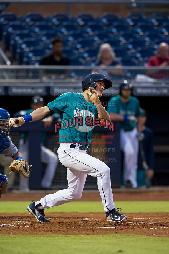 AZL Mariners center fielder Jack Larsen (12) follows through on his swing against the AZL Royals on July 29, 2017 at Peoria Stadium in Peoria, Arizona. AZL Royals defeated the AZL Mariners 11-4. (Zachary Lucy/Four Seam Images)