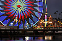 The Grand Wheel at the San Diego County Fair spins with its kaleidoscope of colorful lights on 2011.  photo for North County Times