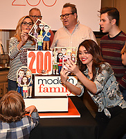 LOS ANGELES - NOVEMBER 15: Julie Bowen, Ed O'Neill, Eric Stonestreet, Sarah Hyland, and Nolan Gould celebrates Modern Family's 200th episode at the Fox Studio Lot on November 15, 2017 in Los Angeles, California. The cake was created by The Butter End. (Photo by Frank Micelotta/Fox/PictureGroup)