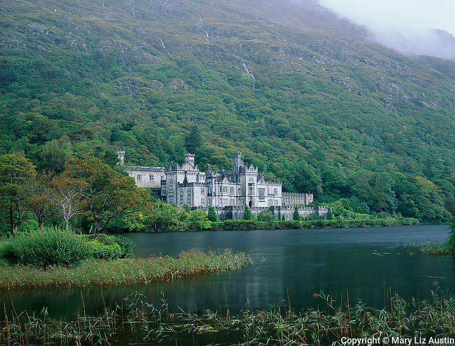 County Galway, Ireland:  Kylemore Abbey sheltered by the slopes of the Twelve Bens on the shoreline of Kylemore Lough in the Connemara region