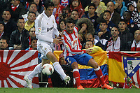 11.04.2012 MADRID, SPAIN - La Liga match played between At. Madrid vs Real Madrid (1-4) with hat-trick of Cristiano Ronaldo at Vicente Calderon stadium. The picture show Ricardo Izecson Kaka (Brazilian midfielder of Real Madrid) and Adrian Lopez Alvarez (Spanish striker of At. Madrid)