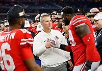Ohio State Buckeyes head coach Urban Meyer high fives offensive lineman Isaiah Prince (59) following their 24-7 win over the USC Trojans in the Goodyear Cotton Bowl Classic at AT&T Stadium in Arlington, Texas on Dec. 29, 2017. [Adam Cairns / Dispatch]