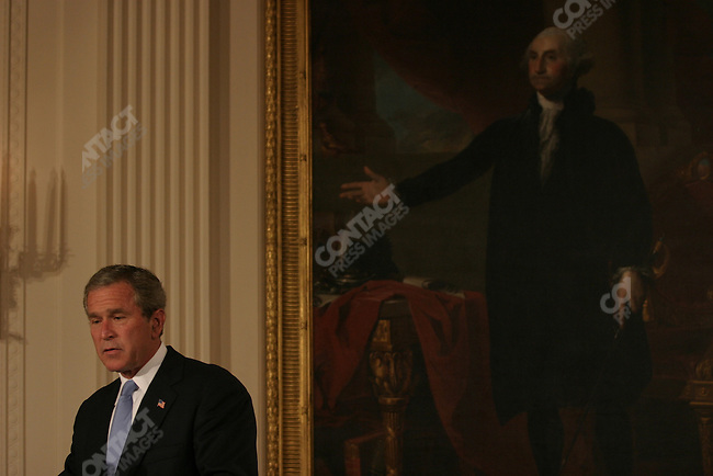 President Bush speaks at the ceremony for the 2003 recipients of the Presidential Medal of Freedom in the East Room of the White House Wednesday, July 23, 2003. Recipients were: Charles Barzun, grandson of Jaques Barzun; Ms Philadelphia Cousins, nephew of Julia Child; Vera Clemente, wife of Roberto Clemente; Van Cliburn; Vaclav Havel; Charlton Heston; Wendy Teller, son of Edward Teller; Lorraine Thomas, wife of David Thomas; Marion White, wife of Byron White and John Wooden. The medal is the highest civilian award of the U.S. Government. Washington, D.C. July 23, 2003.