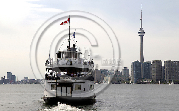 Toronto, Ontario, Canada - 06 August 2006 -- Ferry boat approaching the skyline, city with CN Tower -- architecture, infrastructure, tourism, transport, landmark -- Photo: Horst Wagner / eup-images