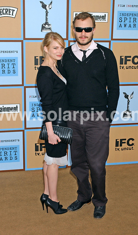 **ALL ROUND PICTURES FROM SOLARPIX.COM**.**NO SYNDICATION IN FRANCE**.Heath Ledger and Michelle Williams arrives at the Independent Spirit Awards on the beach in Santa Monica, Ca.USA on March 4, 2006.  ..JOB REF: 2164 GLS        Date: 04_03_2006