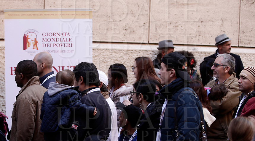 Alcuni fedeli arrivano per un pranzo offerto da Papa Francesco alle persone bisognose in Aula Paolo VI, in Vaticano, 19 novembre 2017.<br /> Pranzo offerto ai bisognosi (senzatetto, migranti, disoccupati) dopo la celebrazione da parte di Sua Santità di una Messa in occasione della prima Giornata Mondiale dei Poveri.<br /> Faithful arrive for a lunch in Paul VI Hall  at the Vatican on Sunday, November 19, 2017. <br /> Pope Francis offers to a several hundred poor people (homeless, migrants, unemployed) a lunch after celebrating a special mass to mark the new World Day of the Poor.<br /> UPDATE IMAGES PRESS/Isabella Bonotto<br /> <br /> STRICTLY ONLY FOR EDITORIAL USE