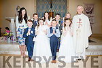 Pupils from Foilmore NS who made their First Holy Communion on Sunday last pictured here front l-r;Aodhán O'Sullivan, Caoimhe Hurley, Enda Sheehan, Karen Quirke, back l-r; Cara O'Sullivan(Teacher), Kevin Griffin, Meabh O'Sullivan, Dan Moriarty, Rachel Fogarty & Canon Larry Kelly.
