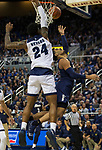 Akron guard Loren Cristian Jackson (1) shot is blocked by Nevada forward Jordan Caroline (24) in the second half of an NCAA college basketball game in Reno, Nev., Saturday, Dec. 22, 2018. (AP Photo/Tom R. Smedes)
