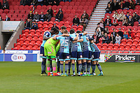 The Wycombe Wanderers teaming a huddle ahead of the Sky Bet League 2 match between Doncaster Rovers and Wycombe Wanderers at the Keepmoat Stadium, Doncaster, England on 29 October 2016. Photo by David Horn.