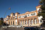 White taxis outside historic railway station building, Jerez de la Frontera, Spain