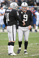 December 18, 2011 Oakland, CA: Oakland Raiders kicker Sebastian Janikowski #11 and punter Shane Lechler #9 during an NFL game played between the Oakland Raiders and the Detroit Lions at O.co Coliseum. The Lions defeated the Raiders 28-27.