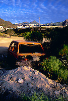 Car dumped and stripped abandoned in desert area. Cabo blanco, Tenerife, 1994