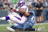 Minnesota Vikings quarterback Donovan McNabb (5) is tackled by Seattle Seahawks defensive end Raheem Brock (98) at CenturyLink Field in Seattle, Washington. The Minnesota Vikings won the game, 20-7.