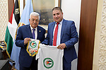 Palestinian President Mahmoud Abbas meets with the President of the Palestinian-Algerian Friendship Society in the West Bank city of Ramallah, on July 20, 2019. Photo by Thaer Ganaim
